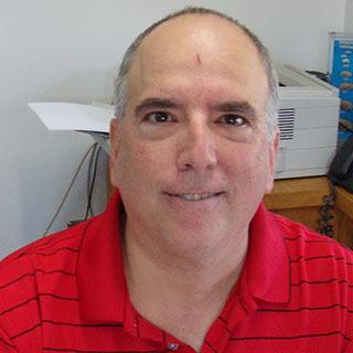Mark J.  Estienne